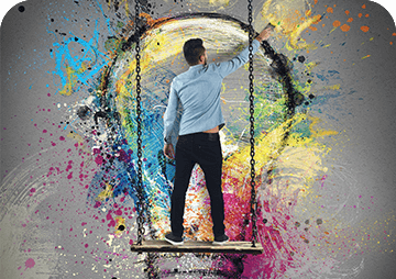 Man Painting a Lightbulb with Multiple Colors